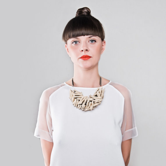 L2 _ triangular beige leather necklacec