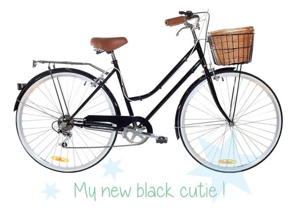 schwarzes-Vintage-Fahrrad-mit-Koerbchen